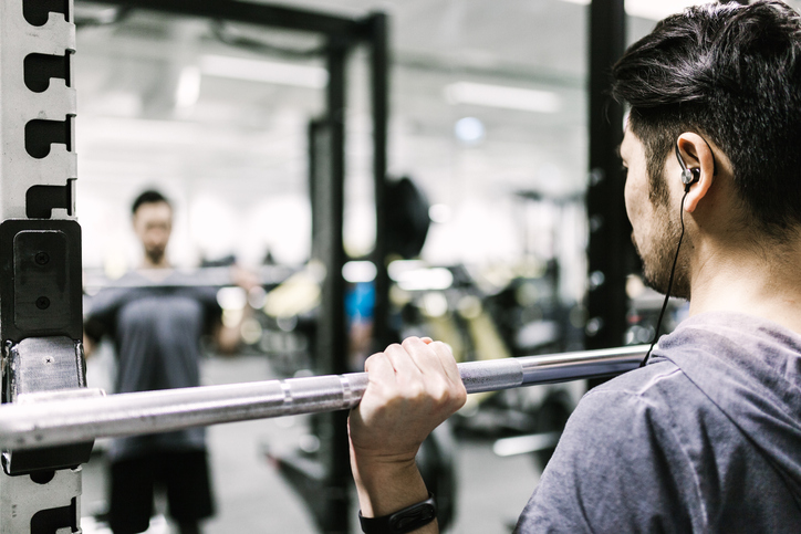 Japanese man trains with barbell in the gym